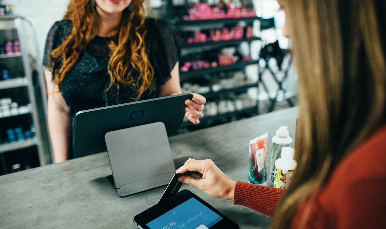 A customer making payment through a POS terminal