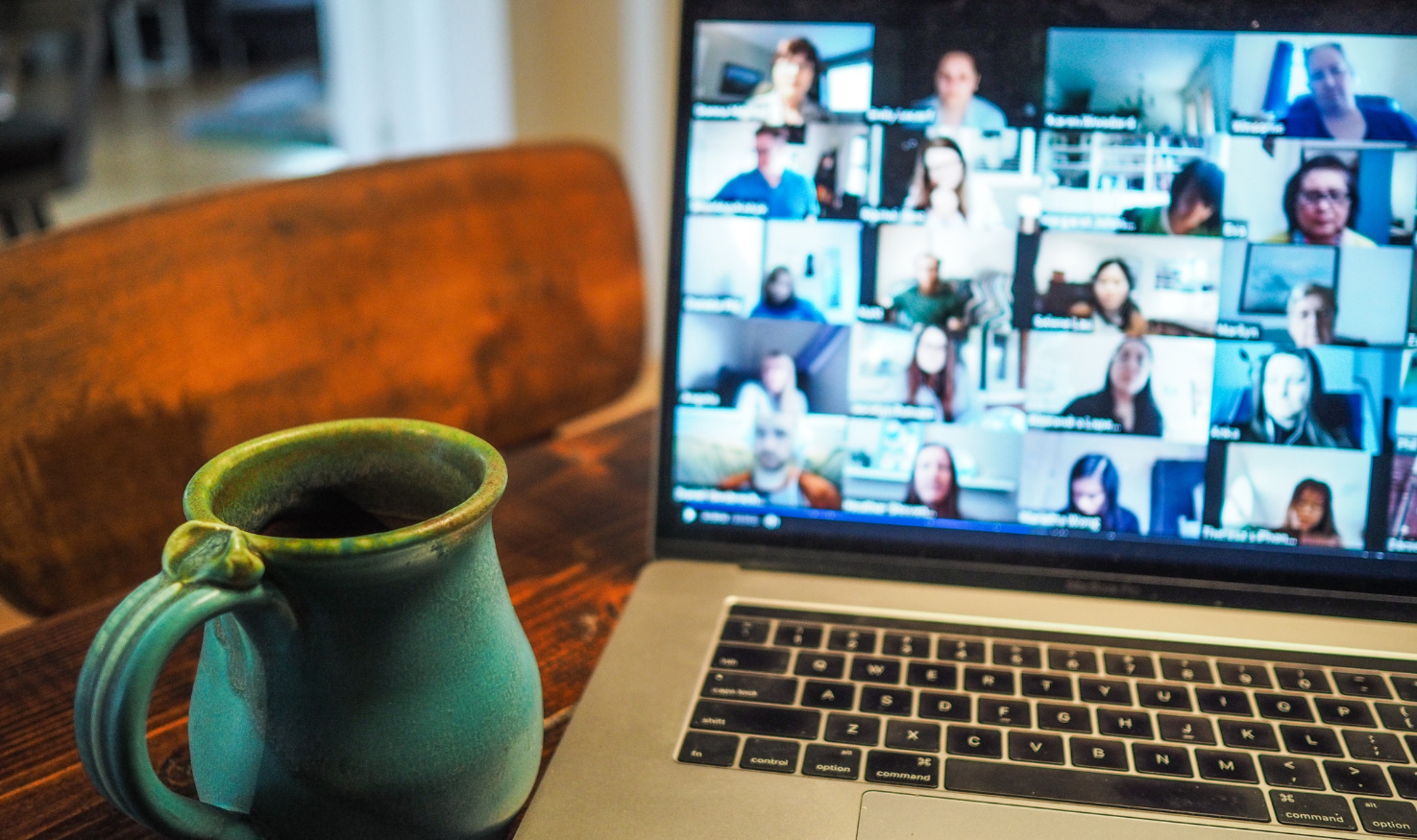 An office meeting through a video conferencing app
