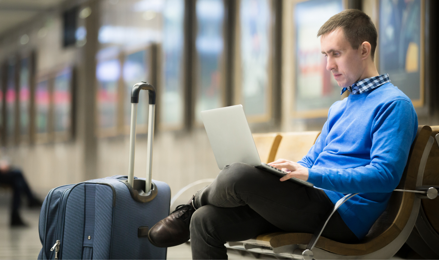 An employee working remotely from a railway station