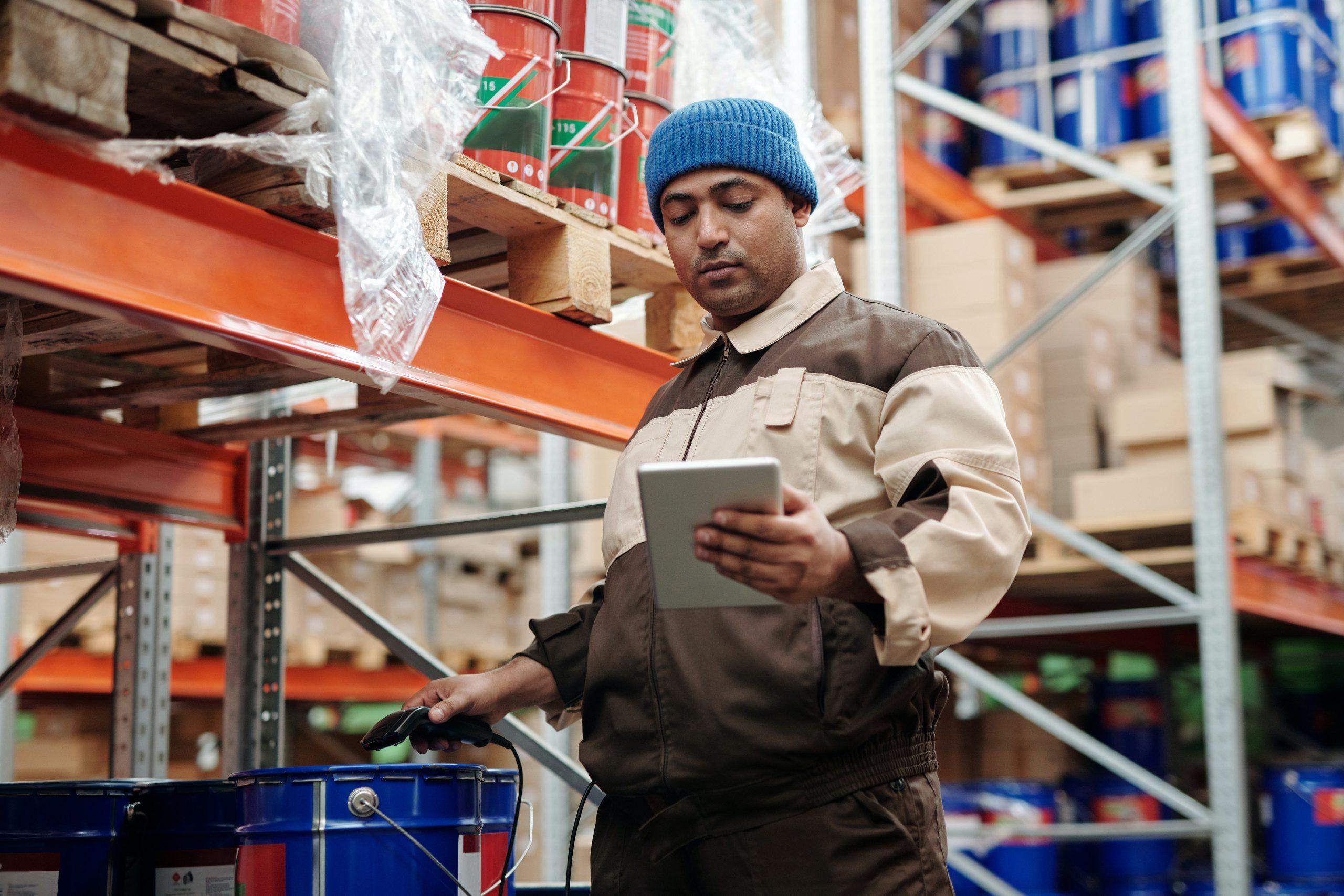 Worker using scanner in an industry
